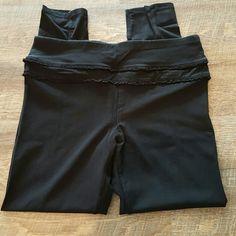 Betsey Johnson performance Black super cute yoga pants. Typical Betsey style.  Hidden seam pocket on waist band. Ruffle detail along top. 90% cotton 1o% spandex. Size L 12-14. Nonsmoking home. Betsey Johnson Pants Leggings