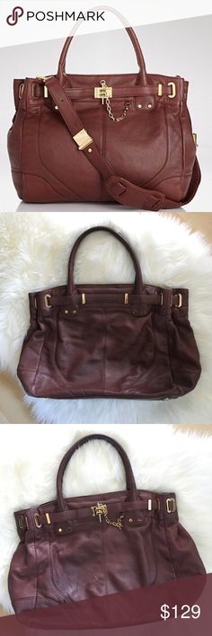 Rachel Zoe Designer Leather Tote This is a really nice size large Tote bag. Perfect for work or running errands. Holds a lot and has a zipper pocket and open pockets inside. It has some scratches here and there which you can see in the pictures but still really good condition with lots of life left. Note: Does not come with the cross body strap. Rachel Zoe Bags Totes