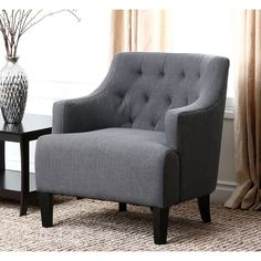 Add a contemporary seating option to any room with this attractive gray fabric armchair that features a tufted-back design. Covered in luxurious linen, the comfortable upholstered chair has contrasting legs and a hardwood frame for added stability.