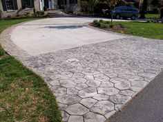 Faux cobblestone at end and around edges of driveway