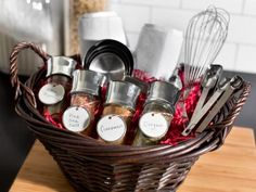 Kitchen essential gift baskets are a classic choice for homeowners spending their first holiday in a new home. Make the basket as practical as it is stylish by outfitting it with basics every homeowner is sure to need. In addition to tools and gadgets, mix in a few pantry essentials such as spices or gourmet condiments.