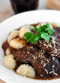 Pasticada: Croatian slow-cooked beef with garlic, cloves and carrot.