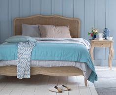 Our Margot weathered oak bed is inspired by a beautiful French bed we fell for in Provence. The lovely rattan headboard is super practical too.