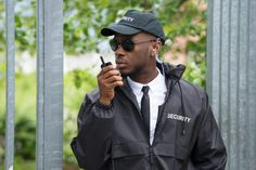 Guard Using Walkie-Talkie. Young Male Security Guard In Black Uniform U ,Security Guard Using Walkie-Talkie. Young Male Security Guard In Black Uniform U , Serbian CAJ Cerberus Solutions Inc. an underrated lewk honestly, 1850 clothing Corporate Security, Event Security, Safety And Security, House Security, Cpr Training, Security Training, Safety Training, Security Services Company, Security Guard Companies