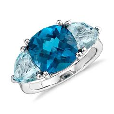 Indulge in color with this three-stone ring featuring a cushion shape London blue topaz and two trillion shape sky blue topaz gemstones set in white gold. Blue Topaz Ring, Topaz Gemstone, Gemstone Jewelry, Blue Nile Jewelry, Turquoise Rings, Pretty Rings, Blue Gemstones, London Blue Topaz, Birthstone Jewelry