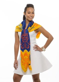 Be bold and edgy by wearing this fashion statement scarf. This image embodies love and is inspired by Haiti's folk symbols. The combination of colors forms the perfect balance of class and individuality. The matchless look of this accessory is too fashionable to pass up. #vevellefashion #vevellescarfie #vevelle