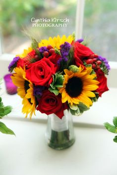 Sunflowers will be my main flower; I love the contrast they bring, especially against purple.