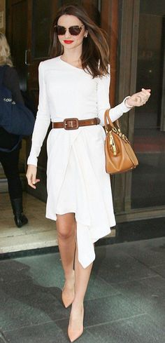STYLE ICON: Miranda Kerr looking chic in white along with tanned accessories
