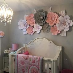 Paper flower wall in girls bedroom. Grey, pink and white.