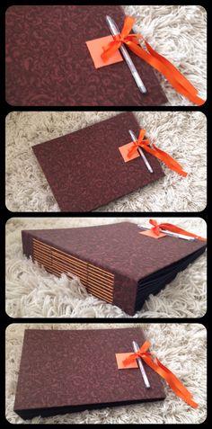 Álbum de fotos, com capa em tecido, encadernação longstitch, páginas em papel duplicolor preto 180 gr.