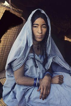 A Tuareg Woman at Her Tent Entrance, Niger.  by Victor Englebert.