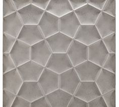 Kitchen: Another Ogassian tile (concrete) from Ann Sacks, Penta Field in Light Grey.