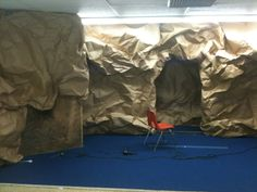 Creative Construction: How to make a cave out of paper. We could also use brown grocery bags.