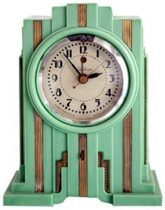 "Telechron American Art Deco Skyscraper Clock in Mint Green  Produced from about 1929 till 1931 this skyscraper styled American art deco table clock was made by the Warren Telechron Company.  Known as the Model 700 and marketed as the ""Electrolarm"", the clock came in three colors; walnut (brown Bakelite) and white or green ""Vinylite"" (Plaskon).  Brown colors are the most common, green the rarest."