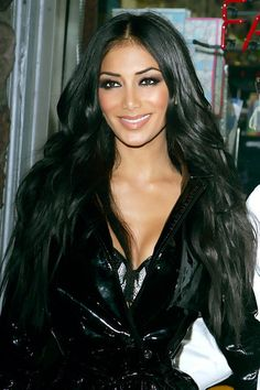 nicole scherzinger-beautiful AND she can REALLY sing... I didn't know how well until today... Seriously,  YouTube her!