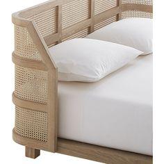 supra bed - woven cane headboard and whitewashed oak