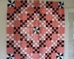 Ludlow Quilt and Sew Co. Nine patch pinwheel quilt