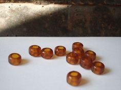Amber glass pony beads by allthatglittersbeads on Etsy, $2.50