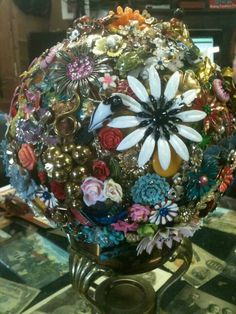 I didn't make this one, but I have started collecting the materials to make one myself. It is made from a bowling ball covered with old jewelry.