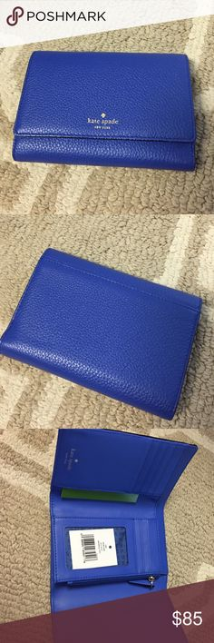 "NWT blue Kate Spade wallet 7 cardslots. 3 slots on the sides. 1 billfold. 1 pocket inside for coins. 1 slip pocket outside. Color is ""island deep."" kate spade Bags Wallets"