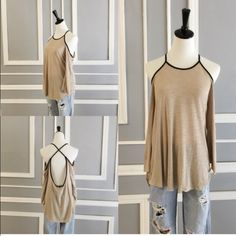 April Spirit Cold Shoulder Top April Spirit backless top with shoulder cutouts. Loose flowy fit and very soft. Material is 96% rayon, 4% spandex. Reasonable offers accepted April Spirit Tops