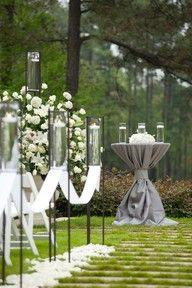 Tall table drapped in fabric for unity candles or sand