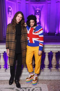 Soko in a Gucci Cruise 2017 Union Jack knit, yellow trousers and platform sneakers and her brother Maxime at the Gucci Fall Winter 2017 after party.