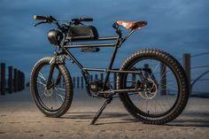 This awesome E-Bike is inspired by a scrambler motorcycle! Built by Dutch custom bicycle workshop Timmermans Fietsen, the spectacular Scrambler E-Bike features a frame from a transport bike, fat studded tires, a raised handlebar, a custom built h E Bicycle, Leather Bicycle, Bicycle Design, Velo Vintage, Vintage Bikes, Cool Bicycles, Cool Bikes, Velo Biking, Moto Cafe