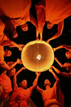 Monks fire a floating lamp in Chiangmai, Thailand by tentor. A Culture of Celebration: What Festival Season Looks Like Around the World