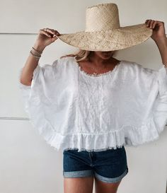 The Wayan Top is a cropped design with 3/4 sleeves and wide ruffle frills. The bouncy lightweight linen makes this top a summer staple.  - f e a t u r e s -  - Relaxed Fit - Fringe tassel trim on hemlines - Scooped round neckline - Frill Trim  - c o l o u r s -  White or Natural Linen  Please note that the white linen is semi-sheer, making it a great layering piece.  Natural Linen is not sheer. - f a b r i c a t i o n -  Pure Linen Cold gentle machine wash. Do not tumble dry. - s i z e ...