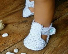 Exquisite gift for the holiday every little lady :) Crocheted baby booties. I used organic cotton - does not cause allergies and is easily maintained. Decoration - ribbon organza and satin flower. A great choice for а handmade gift!  0-3 m =7-8cm = 2 3/4 - 3 1/8 3-6 m =9-10 cm = 3 1/2 - 4 6-12 m =11-13 cm =4 3/8 - 5 1/8  Hand wash recommended / Flat dry / No ironing  Email me if you have any questions.  Shipping: via Bg post-Airmail (registered mail).