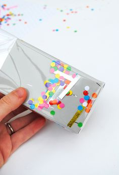 'shake-it' confetti wrap // by minieco....a great gift wrap tutorial. For Christmas time think snowflakes, Christmas trees, stockings, etc. Or just xmas colors
