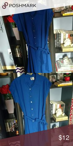 Never worn, gorgeous blue button-up dress Never worn blue button-up dress. Comes with blue tie around the waist. Pair it with leggings or some booties and this is a great look for many occasions! Japna Dresses