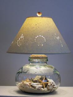Glass lamp filled with seashells and sand!