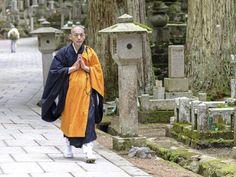 Mount Koya, Japan: village sanctuary for body and spirit |  A Shingon Monk walking in Japan's largest burial ground, Okunoin cemetery, Koyasan. Picture: iStock