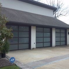 Clopay Avante Collection Full View Aluminum Anodized Bronze Obscure Glass  Garage Doors, The Overhead Door