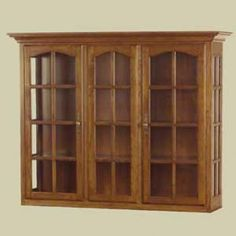 """Redux Antique Hardwood China Cabinets – 63"""" wide Heritage Colonial China Cabinet with Glass Panel Sides & Cathedral Arch Doors. Caringly hand-built & hand-finished by Mennonite & Amish craftsmen. Available in premium Oak, Maple, or Cherry hardwoods and a full range of durable finish colors. Find the Heritage Colonial China Cabinet with Glass Panel Sides & Cathedral Arch Doors at http://www.mennonite-furniture-studios.com/Amish-Heritage-Colonial-China-Cabinet-Top,-63-inch/"""