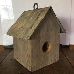 Hand crafted in Nebraska from reclaimed material! Any bird will probably appreciate the little tin roof. Is about 10 inches tall.