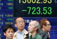 Asian stock markets mixed after US lukewarm data