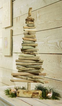 Stunning, modern hand-crafted driftwood Christmas tree features adjustable wood branches and real log base. Measures: 24 x 6 Twig Crafts, Beach Crafts, Recycled Crafts, Craft Stick Crafts, Holiday Crafts, Christmas Wonderland, Christmas Time, Christmas Ornaments, Driftwood Projects