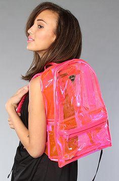 "Translucent vinyl backpack with logo plaque detail; exterior zip pocket; zippered main closure; padded adjustable shoulder straps; faux leather trim.    Measures 12"" W x 18"" H x 6"" D    By Joyrich"
