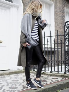 Lucy Williams is wearing a pair of black leather pants from .crew, with a grey scarf from Acne and Nike Air-max Thea.