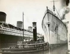 The Cunard liner RMS Queen Elizabeth 'The Grey Ghost'; Normandie alongside.