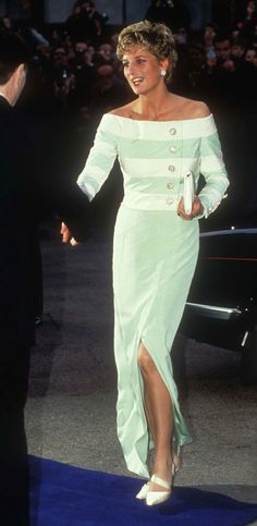"""Lot 17.  Catherine Walker dinner dress of eau-de-nil green & cream silk crepe.  Five jewelled paste buttonsplaced asymmetrically on the bodice.  Skirt is slim.  It was worn at the film premiere of """"Accidental Hero"""" in 1993 and to official dinners.  Raised $34,500"""