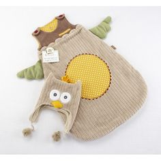 Not so much on the snuggle sack, but oh, how I would love to put that owl hat on Noah!