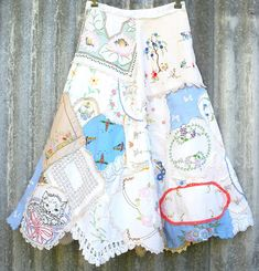 Repurposed: Hankies, doiles, vintage fabric patchwork skirt.  Clothing as art!  Would be a cute way to make an apron!