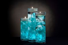 Turquoise Floral Centerpieces with LED Lights and Floating Candles #floatingcandles
