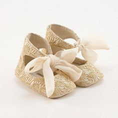 Leather baby shoes  covered with golden lace.