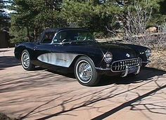 1957 Black Corvette with bullet side