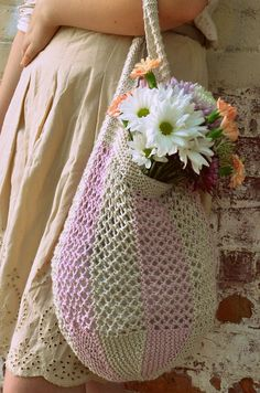 Free Knitting Pattern for Taffy Market Bag - Striped lace mesh tote with garter stitch bottom shaped with short rows. Worsted. Designed by The Noble Thread